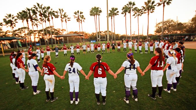 After an 11-3 loss, the Owls and members of Central Arkansas stand in a circle of prayer in recognition of the program being eliminated. | COURTESY BRADLEY WIDDING