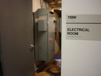 Mechanics worked to repair damage in an electrical room inside Temple Towers after a steam pipe burst, causing a power outage in the building in the early morning hours on Saturday. | John Moritz TTN