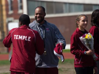 Coach Eric Mobley (center) congratulates senior sprinter Marcus Robertson (left) in a ceremony honoring the seniors of the men's and women's track & field teams. // ABI REIMOLD // TTN