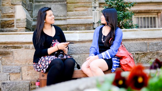 """Kaniz Pramanik interviews Professor Marybeth Acac last Thursday after taking her photo for """"Humans of Temple University."""" She will post the professor's responses as the caption of her photo on the project's Facebook page. 