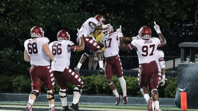 P.J. Walker (center) celebrates with teammates after rushing for a touchdown in the third quarter of Temple's 37-7 win at Vanderbilt Thursday. | Hua Zong TTN
