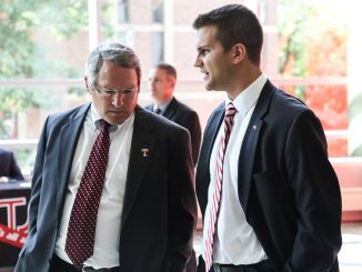 President Theobald (left) and TSG President Ray Smeriglio talk shortly before Theobald spoke to the General Assembly
