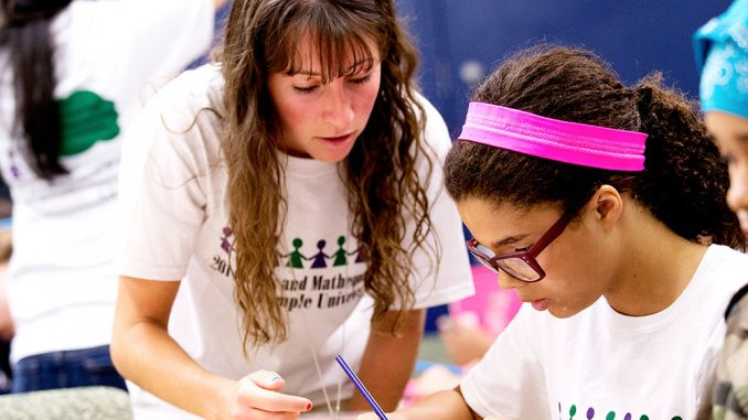 Female Temple students work with girls in grades five through eight to help build their confidence in mathematics. | COURTESY RYAN BRANDENBERG