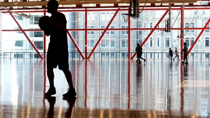 Students play basketball in the Fitness Mezzanine of Pearson and McGonigle Halls. Students can receive activity rewards through two fitness programs. Allan Barnes | TTN