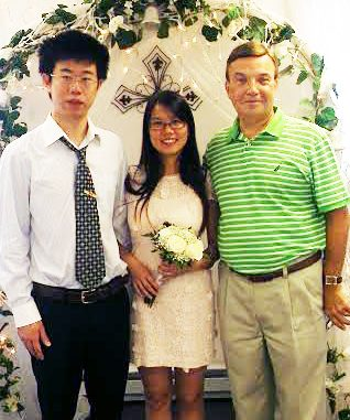 Bill DeSio (right), with Yang and his wife, Xueli Huang, on their wedding day. COURTESY CHRISTINE BRADY