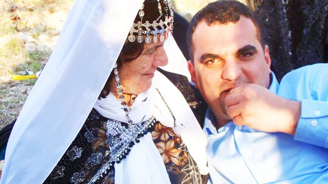 Huner Anwer sits with his grandmother during a Kurdish picnic in March 2012. COURTESY HUNER ANWER