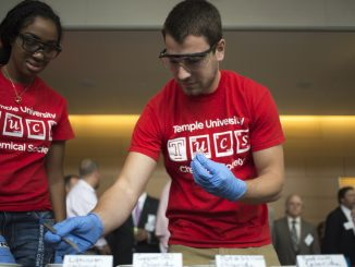 Member Jessica Fenton (left) and Vice President Brandon DeMauro of the Temple University Chemical Society conduct science experiments during the SERC opening on Friday. Kara Milstein | TTN