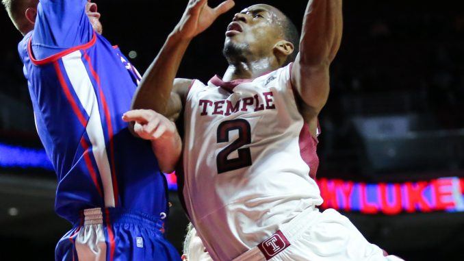 Senior guard Will Cummings attempts to drive to the basket in Temple's 40-37 defeat of American. | Hua Zong TTN