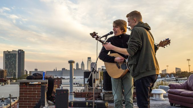 Eric Doguet and Robbie Fischer of Eric & Robbie perform at The Block Jam, a rooftop concert at the corner of Diamond and Carlisle streets, held on Nov. 9. Kara Milstein | TTN