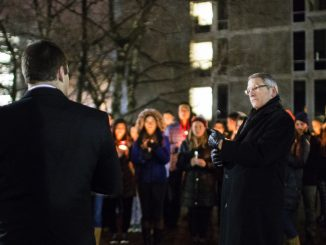 President Neil Theobald stood among students and faculty Jan. 23 at the candlelit vigil. | Kara Milstein TTN