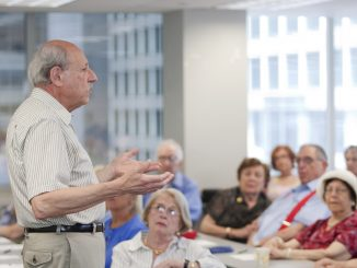 Members of Temple's Osher Lifelong Learning Institute listen to a lecture in a classroom. | COURTESY Adam Brunner