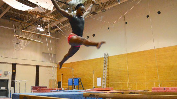 Sophomore all-around Briana Odom practices on the balance beam. | Sasj Schaeffer TTN