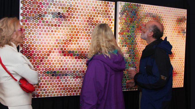 "Patrons admire ""Mandella and Liz"" by Gavin Rain at the E-Moderne Gallerie. | COURTESY E-MODERNE GALLERIE"
