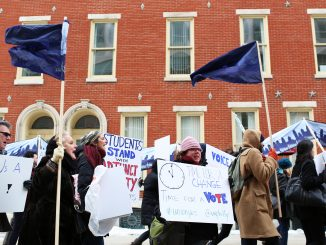 """Adjunct professors chant, """"Let us vote,"""" as they march down Liacouras Walk on Feb. 23. Pending a March 19 hearing with the Pennsylvania Labor Relations Board, adjuncts are demanding a vote for or against unionization.   Kara Milstein TTN"""