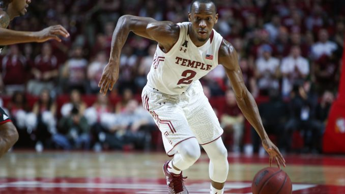 Point guard Will Cummings handles the ball during the Owls' 75-59 win against Cincinnati Feb. 10. On Sunday, Cummings was limited to just 23 minutes of foul trouble. | Jenny Kerrigan TTN