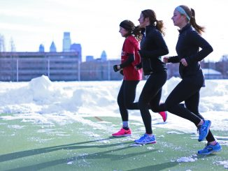 Runners Megan Schneider, (left), Andrea Mathis and Danielle Britton jog at Geasey Field last month. | Jenny Kerrigan TTN