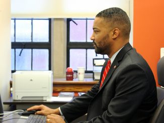 Senior Vice President for Government, Community and Public Affairs Ken Lawrence uses the computer in his office. | Alex Beaufort TTN