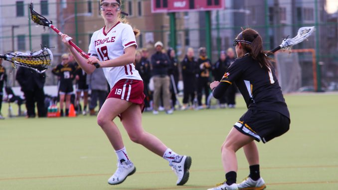 Freshman attacker Nicole Barretta cradles the ball during the Owls' 10-9 overtime win against UMBC. Barretta has four goals in her first two games as an Owl. | Jenny Kerrigan TTN