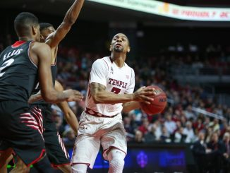 Senior guard Jesse Morgan holds the ball on offense in Temple's 75-59 triumph against Cincinnati Tuesday. Morgan had 12 points in the win. | Jenny Kerrigan TTN