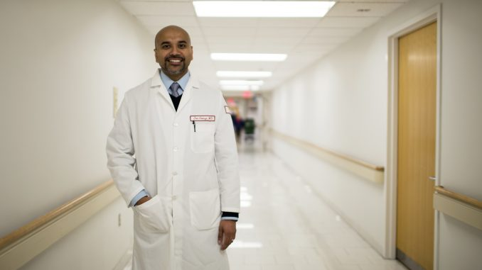 Dr. Jon C. George, an interventional cardiologist and an adjunct professor, stands in Temple University Hospital. George is in charge of a nationwide clinical trial. | Kara Milstein TTN