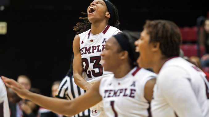 Senior guard Tyonna Williams celebrates the Owls' 80-79 Women's National Invitation Tournament overtime home victory against North Carolina State last Thursday. Williams has averaged 17.5 points in the team's last two postseason games. | Donald Otto TTN