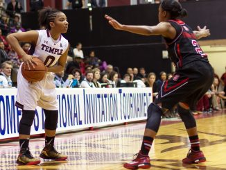 Standout freshman guard Alliya Butts scans the defense in the Owls' 80-79 win last Thursday against North Carolina State. | Donald Otto TTN