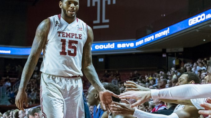 Junior forward Jaylen Bond high-fives teammates during the Owls' 90-77 win against George Washington in the second round of the National Invitation Tournament. Bond recorded 15 rebounds and eight points. | Chip Frenette TTN