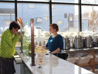 Employee Tara Scott offers a customer a sample of one of Good Spoon's signature soups.   Eamon Dreisbach TTN
