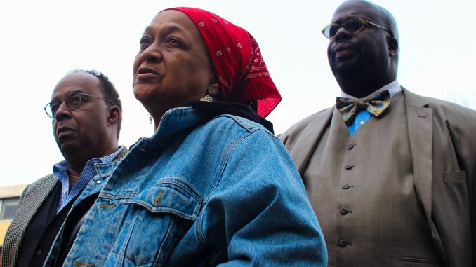Dr. Anthony Monteiro (left), activist Pam Africa and president of Black Men at Penn Chad Lassiter at a protest held March 11 at Sullivan Hall.   Bree Hansteen TTN
