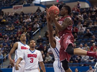 Junior guard Quenton DeCosey (right) fights for possession in Temple's 69-56 loss to Southern Methodist in the conference semifinals on Saturday. The Owls will take part in the National Invitation Tournament for the first time since the 2005-06 season under former coach John Chaney. That season was Chaney's last as Temple coach. | Donald Otto TTN
