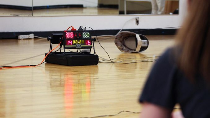 The fencing team uses electronic scoring to record points for all of its events. | Alex Beaufort TTN