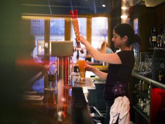 At Earth - Bread + Brewery, Liz Martino, bartender, pours a drink from one of 11 beers on tap that are constantly changing. | Margo Reed TTN