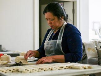 Amanda Eap rolls dough used to make authentic croissants, Artisan Boulanger Patissier's speciality.   Eamon Dreisback TTN