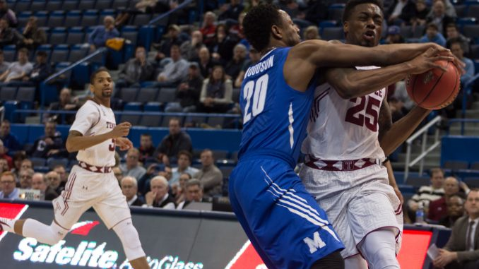 Owls junior guard Quenton DeCosey (right) attempts to drive past Memphis junior guard Avery Woodson in Temple's 80-75 defeat of the Tigers Friday in an American Athletic Conference tournament quarterfinal. DeCosey finished with 14 points and a team-high eight rebounds. | Donald Otto TTN