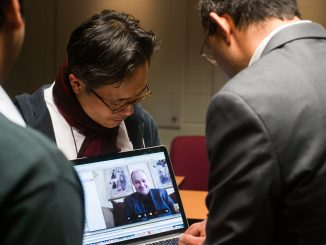 Sunil Wattal and Youngjin Yoo talk to Zoran Obradovic via Skype to discuss research. | Allan Barnes TTN