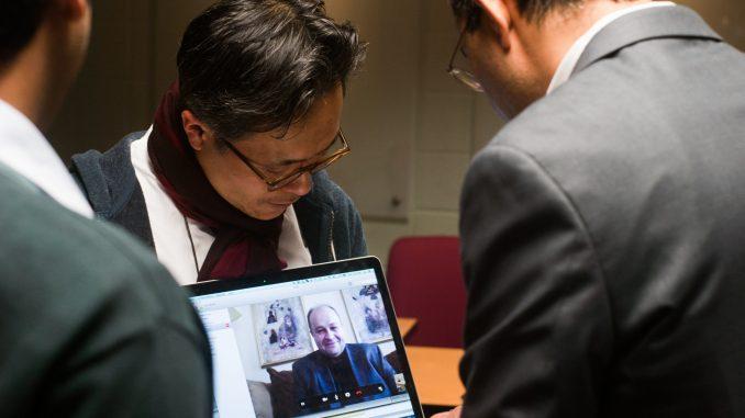 Sunil Wattal and Youngjin Yoo talk to Zoran Obradovic via Skype to discuss research. | Allan Barnes TTN