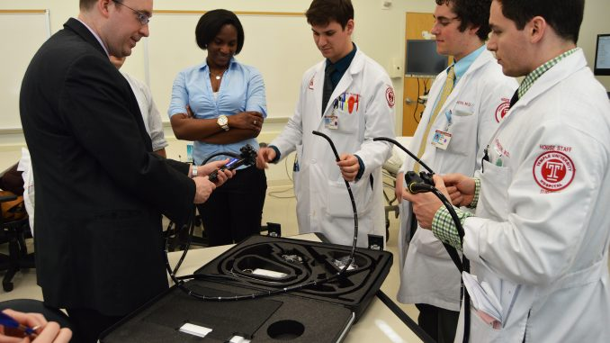 Assistant professor Dr. Matthew Philp teaches a group of residents about a new machine that allows students to simulate upper endoscopy, colonoscopy and bronchoscopy procedures at the Temple Medical School. | Alexa Zizzi TTN