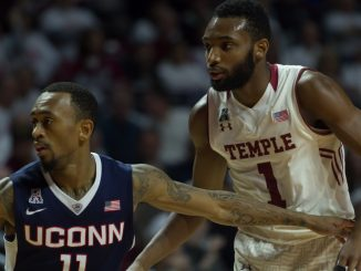 Temple junior guard Josh Brown (right) covers Connecticut senior guard Ryan Boatright in the Owls' 75-63 win against Connecticut Saturday. Boatright finished with a game-high 25 points, but only scored four in the second half en route to Temple's comeback victory. | Donald Otto TTN