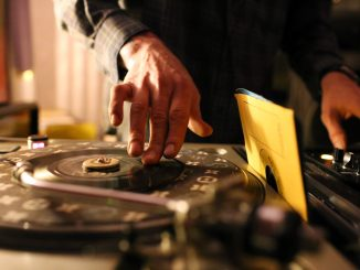 DJ Steve Ferrell spins a variety of vinyl when he performs at Sarah's Place, located at 29th and Girard streets. | Kara Milstein TTN