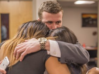 Incoming Student Body President Ryan Rinaldi embraces Brittany Boston and Binh Nguyen, the new vice presidents for services and external affairs, respectively. Their ticket, Future TU, won the Temple Student Government elections with 66 percent of the vote on Thursday. | MARGO REED TTN