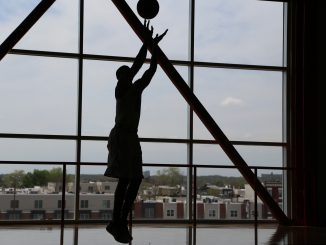 Former team captain and senior guard Will Cummings practices his three-point shots in the McGonigle Hall practice facilities last Friday.   Jenny Kerrigan TTN