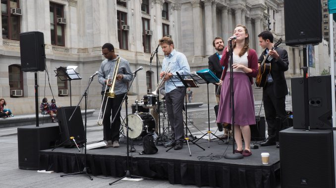 Chelsea Reed and the Fair Weather Five perform at Dilworth Park as part of an ongoing concert series.