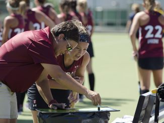 Coach Marybeth Freeman talks with sophomore midfielder Rachael Mueller during the team's 1-0 victory over Drexel University in a scrimmage last Saturday. | Margo Reed TTN