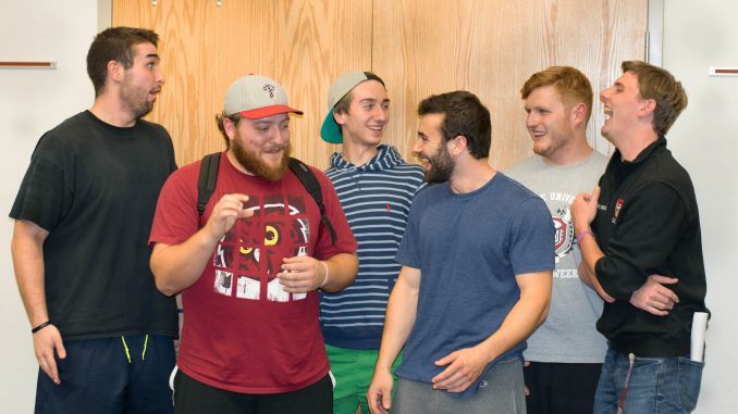 Fraternity members laugh at a recent meeting about the new rushing standards. | Ryan Kuna TTN