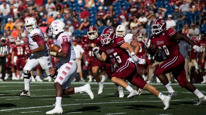 Junior quarterback P.J. Walker evades a UMass defender during the Owls 25-23 win Saturday at Gillette Stadium. | Jenny Kerrigan TTN