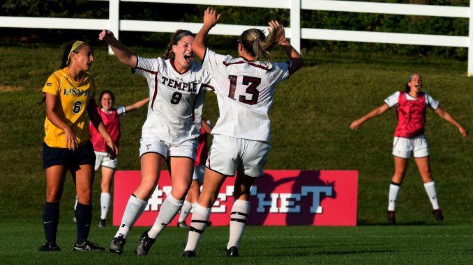 Freshman midfielder Sarah McGlinn celebrates with senior midfielder Kelly Farrell during the Owls' 3-0 win against La Salle Sept. 18. | Geneva Heffernan TTN
