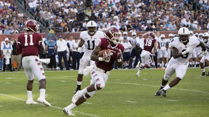 Jahad Thomas carries the ball during Temple's 27-10 victory against Penn State Sept. 5. Thomas ranks third in the Football Bowl Subdivision in rushing yards. | Jenny Kerrigan TTN