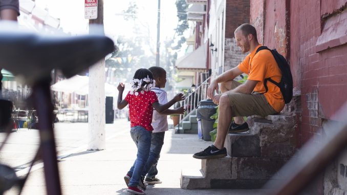 David Suender, founder of the BMX Philly Program, meets children at a block party at 18th and York streets Sept. 7. | Margo Reed TTN