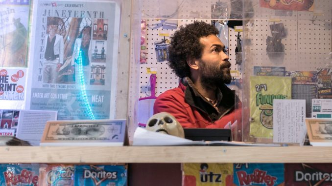 "Keir Johnston, one of the co-founders of the ""La Frontera,"" sits in the bodega created with the goal of building a stronger bond in the North Philadelphia community. 