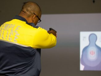 Temple Police officer Damon Mitchell tests the new Ti Training simulator. | Daniel Rainville TTN